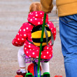 Stock Photo: Little Girl on Kiddie Bike