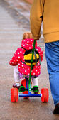 Little Girl on Kiddie Bike — Stock Photo
