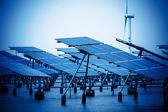 Green energy - solar panels and wind turbine. — Stock Photo