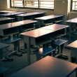 Empty classroom with chairs, desks and chalkboard. — Stock Photo #35704233