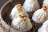 Chinese food, steamed bun in bamboo steamer — Stock Photo