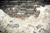 Mottled old brick wall — Stock Photo