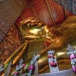 Reclining Buddha gold statue — Stock Photo
