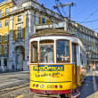 Tram rides through ancient streets — Stock Photo #14008772