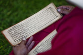 Tibetan monk with a manuscript in his hands — Stock Photo