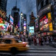 Abstract taxi in Times Square — Stockfoto #14010164