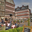 Cafe at Römerberg Plaza in Frankfurt am Main, Germany - Stock Photo