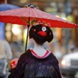 Stock Photo: Geishwith red umbrellin Kyoto, Japan