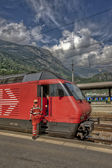 Train at a railway station in the mountains — Stock Photo