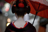 Geiko with umbrella in Kyoto,Japan — Stock Photo