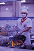 Chef cooking in pan delicious Asian food — Stock Photo