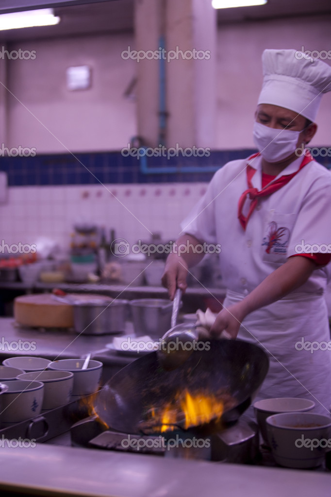 Chef cooking in pan delicious Asian food — Stock Photo #14017409