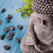 Buddha mit Bambus, Massage Steinen und Schale mit Blten - Stock Photo