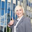 Businessmshowing ok sign — Stock Photo #28450325