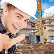 Man showing a sign ok on a background of construction — Stock Photo #28451225