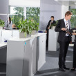 Stock Photo: Office Business Men and Women talking