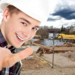 Man showing a sign ok on a background of construction — Stock Photo