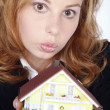 Businesswoman with a toy house — Stock Photo #28452407