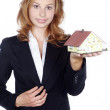 Businesswoman with a toy house — Stock Photo