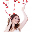 Roses fall on Woman — Stock Photo