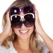 Blonde girl with three glasses — Stock Photo