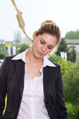 Businesswoman is hung on a rope — Stock Photo