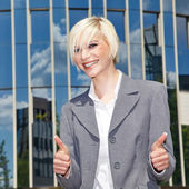 Businesswoman on a background of a skyscraper — Stock Photo