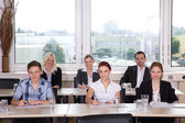 Businessgroup sitting in office — Stock Photo