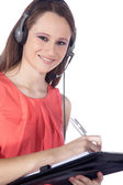 Businesswoman with a notebook in headphones — Stock Photo