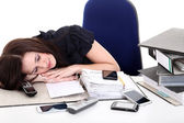 Businesswoman asleep on the desktop — Stock Photo