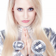 Blonde girl in a silver dress with disco balls — Stock Photo