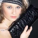 Blonde girl with handbag closeup — Stock Photo