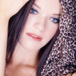 Brunette girl in the Tiger scarf — Stock Photo
