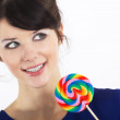 Brunette girl with a sweet candy — Stock Photo