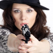 The girl in a hat with a gun  — Stock Photo