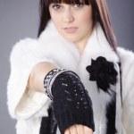 Brunette girl in white fur — Stock Photo