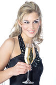Blonde girl with a glass of champagne on a white background — Stock Photo
