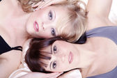 Blonde and brunette girls close-up — Stock Photo