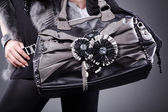 Blonde girl with a bag in black fur — Stock fotografie
