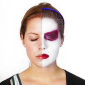Girl with half of her painted face — 图库照片