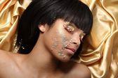 African women face in precious stones — Stock Photo