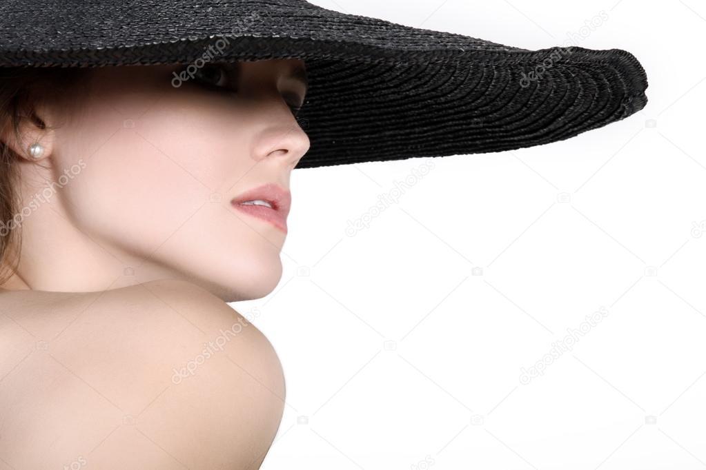 Девушка в черной шляпе стоковое