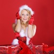 Christmas blonde girl with gifts — Stock Photo #28478431