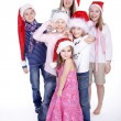 Six children in Christmas hats — Stock Photo