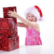 Young girl with Christmas gifts — Stock Photo #28476961