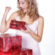 Christmas blonde girl with gifts  — Stock Photo