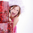 Young girl with Christmas gifts — Stock Photo #28478527