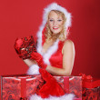Christmas blonde girl with gifts — Stock Photo #28479103
