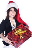 Chica morena de navidad con un regalo — Foto de Stock