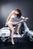 Girl in lingerie on a moped — Stock Photo